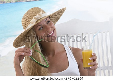 Fashion woman drinking cocktail on the beach background - stock photo