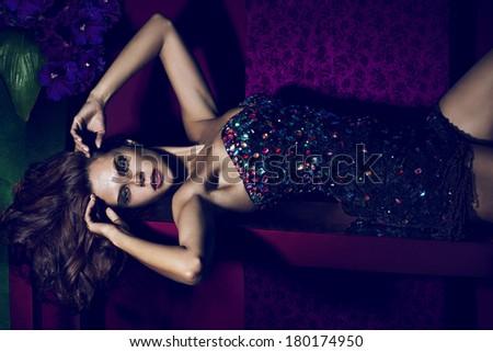 Fashion woman face on dark background - stock photo