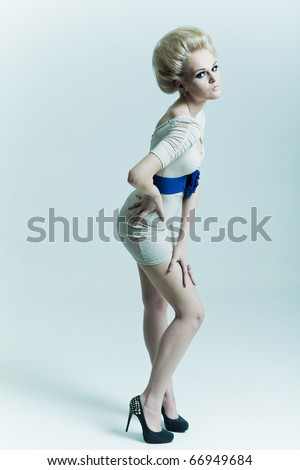 Fashion woman in a dress and heels - stock photo