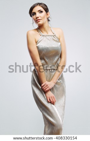 Fashion woman in evening dress portrait. Female young model. Studio isolated , gray background .Long hair. - stock photo