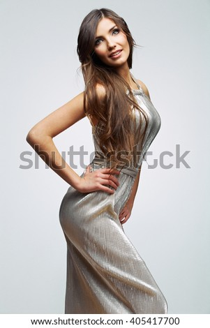Fashion woman in evening silver dress. Female beautiful  young model. Studio isolated. Long hair.