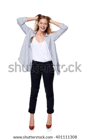 Fashion woman in full length happy smiling laughing over white background - stock photo