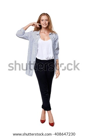 Fashion woman in full length happy smiling posing over white background - stock photo