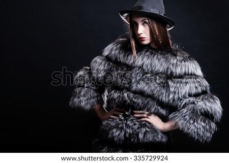 Fashion woman in fur coat - stock photo