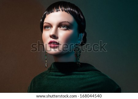 Fashion woman  in green chiffon  dress. Trendy makeup.  Gold jewelry accessory - stock photo
