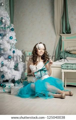 Fashion woman in luxury interior - stock photo