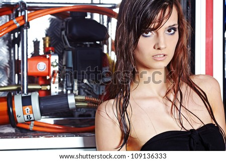 Fashion woman in summer  body  and fire truck