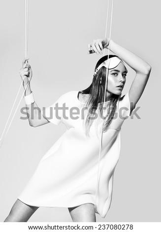 Fashion woman in white dress - stock photo
