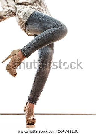 Fashion. Woman legs in denim trousers platform high heels shoes casual style isolated on white background - stock photo