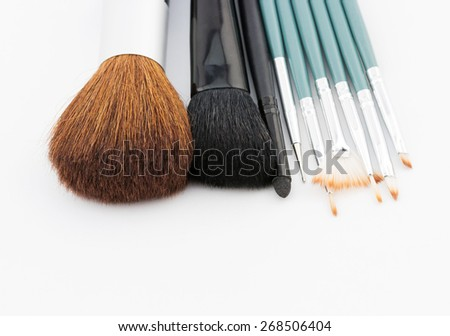 Fashion woman objects. Professional makeup brush set on white background - stock photo