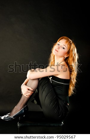 fashion woman on a black background - stock photo