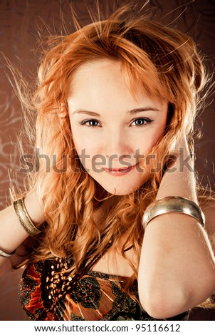 fashion woman on a brown background - stock photo