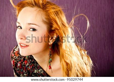 fashion woman on a purple background - stock photo