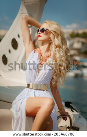 Fashion woman outdoor portrait sexy girl on yacht, vogue style model blonde in white dress fashionable lady, elegant blond outdoors, soft focus, series - stock photo