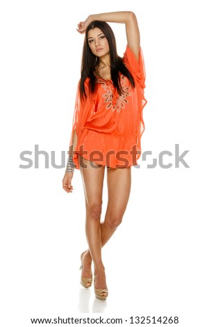 Fashion woman poising in light summer dress in full length over white background - stock photo