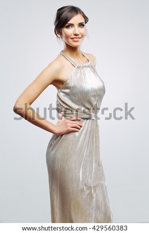 Fashion woman portrait. Girl in evening silver dress.  Studio isolated , gray background . Fashion model studio poses.