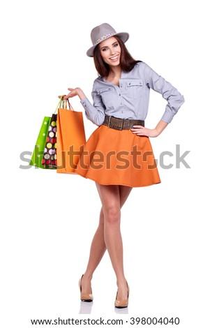 Fashion woman portrait isolated. White background. Happy girl hold shopping bag.  - stock photo