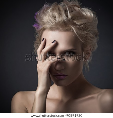 Fashion woman portrait on dark background - stock photo
