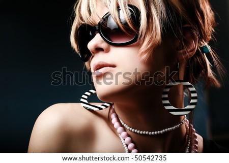 Fashion woman portrait wearing sunglasses - stock photo