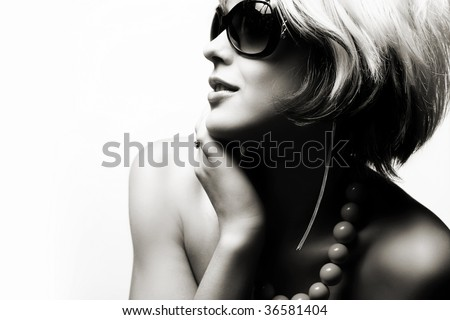 Fashion woman portrait wearing sunglasses on white background - stock photo