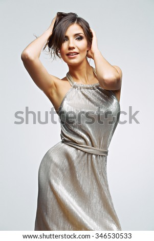 Fashion woman portrait. young model wearing silver evening dress. Studio isolated , gray background . Fashion model studio posing.