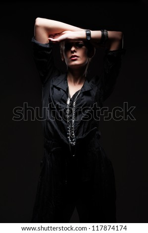 fashion woman posing in darkness - stock photo