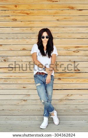 Fashion woman posing outdoor - full length portrait  - stock photo