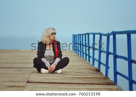 fashion woman relaxing near the sea in autumn time