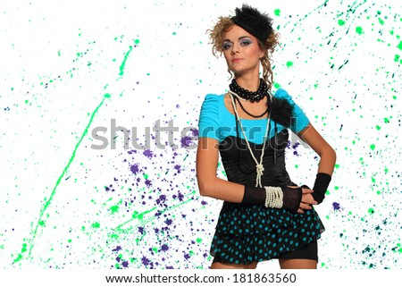 Fashion woman 80's style over pain splatter background - stock photo