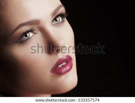 Fashion woman. Stylish makeover. Face close-up. - stock photo