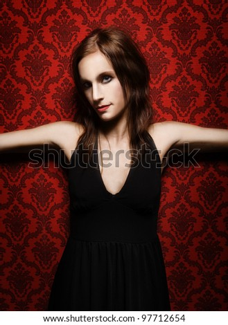 Fashion Woman towards red Background - stock photo