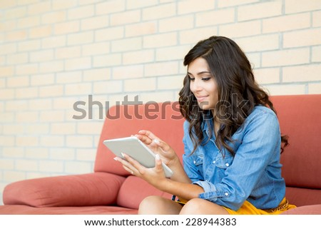 Fashion woman using tablet with lens flare