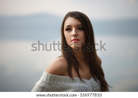 Fashion woman walking outdoor against an autumn  - stock photo