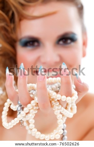 Fashion woman wearing long nails, having jewelery in her hand