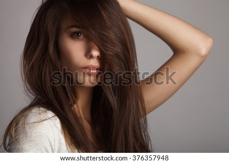 Fashion woman with beautiful face and hair. Skin care concept.