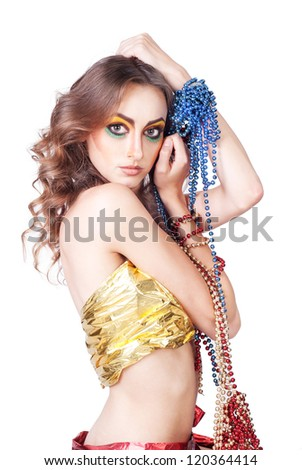 fashion woman with beauty bright make-up posing in studio witn new year beads - stock photo