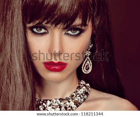 Fashion woman with brown hair and evening make-up. Jewelry and Beauty. Fashion art photo - stock photo