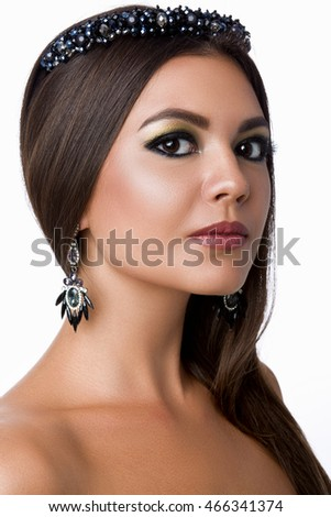 Fashion woman with brown hair and evening make-up. Jewelry and Beauty. Fashion art photo