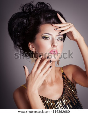 Fashion woman with hairstyle and black nails - stock photo