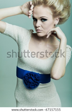 Fashion woman with hands in faces