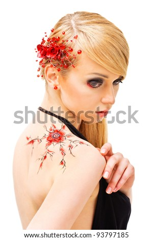 Fashion woman with jewelry and bodyart. Isolated over white