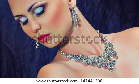 Fashion woman with jewelry precious decorations.