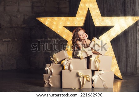 Fashion woman with lots of gifts. Brodway star on background - stock photo