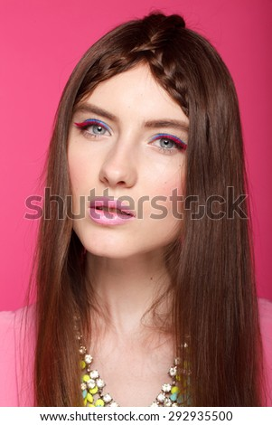 Fashion woman with pink lips , evening make up. Beauty. Portrait. Pink background, studio shot. Perfect skin. Brunette. - stock photo