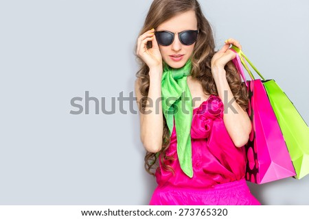 Fashion woman with shopping bags and wearing sunglasses - stock photo