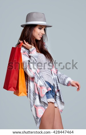 Fashion woman with shopping bags. Studio shoot