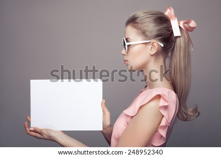 Fashion Woman With Sunglasses Holding Empty Paper Blank In Hands. - stock photo