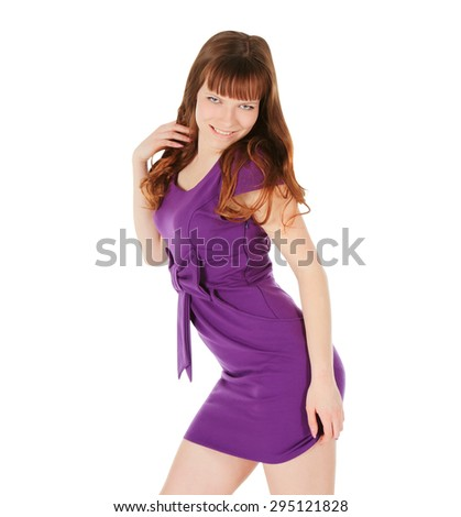 Fashion young brunette in magentas dress posing over white