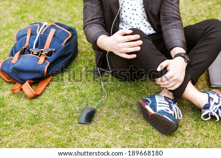 fashion young guys consider shopping with shopping bags in their hands. the background green park.  - stock photo