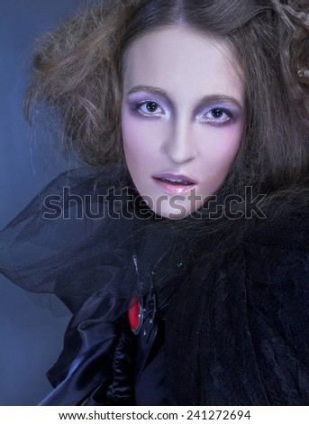 Fashion. Young lady in black and with artistic hairstyle. - stock photo